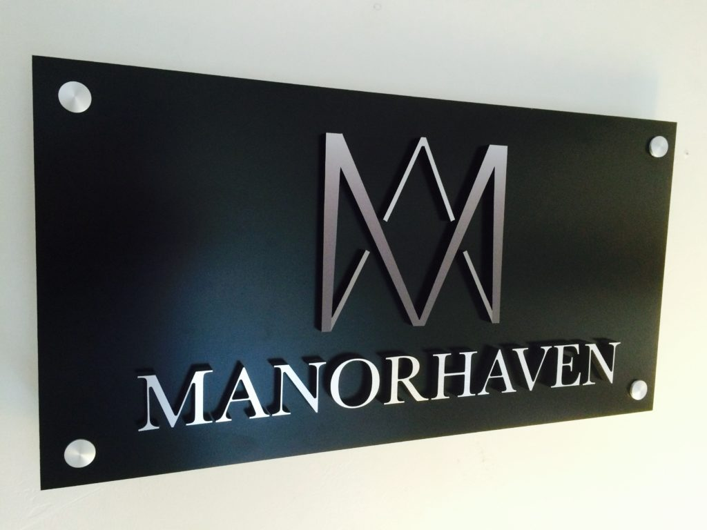 black aluminum plaque with brushed aluminum letters